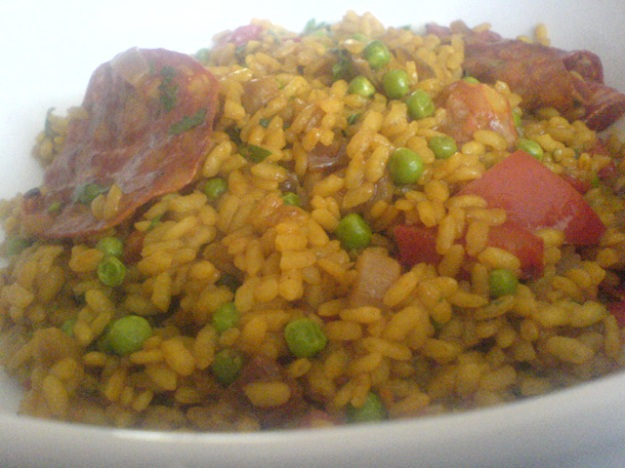 paella with peppers, peas and chorizo