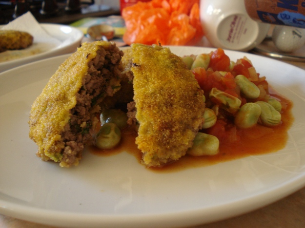 mince patties with a polenta crust, with a tomato and broad bean sauce