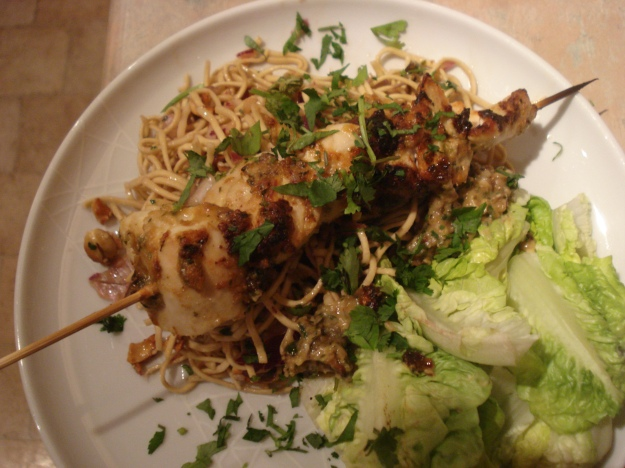 chicken skewers with satay sauce and noodle salad