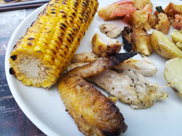 southeast spatchcock chook with boozy-braised sweetcorn, potato salad and panzanella